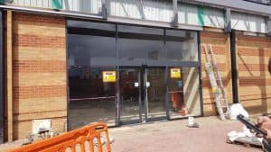 Curtain Walling Repairs and Repaint to Shop Front in Manchester