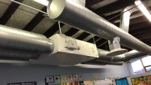 Repairing & Priming an Air Conditioning System for a School.